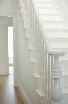 White banister on white staircase White Banister, White Staircase, Banisters, Stair Railing, Railings, Black Stairs, Painted Staircases, Painted Stairs, Painted Floorboards