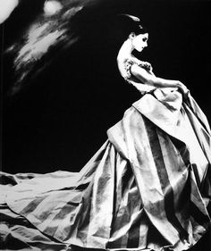 by Lillian Bassman I love how they have used a contamination between, different lighting effects with a black and white canvas to tell the story of the emotions and texture displayed in this photograph.