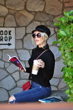 Casual Style... feeling a little #retro #embellishedsunglasses #casualstyle #readingissexy #books #sunglasses #blackandred #redbag #hats #style #easystyle