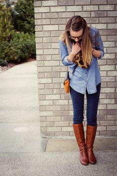 light denim top, dark denim jeans, leopard scarf and brown boots