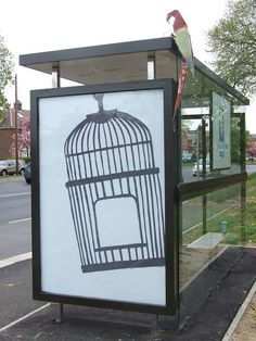 Break Free by EYE-SAW. (Escape the advertisers. Origami parrot made with bus shelter ad)