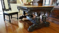 A carved oak antique dining table from the folks at Geaux Vintage Antiques.