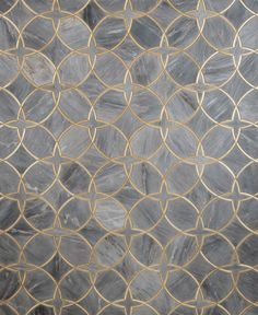 Waterjet design in tile featuring marble and brass inserts