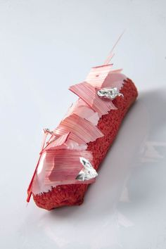 this is rhubarb eclair something or other but looks like it would be amazing if it were savory, like lobster and chive sourcream roll.  - or even some sort of horrific but dainty blood flavored pastry