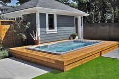 Hydropool Self Cleaning swim spa with wooden enclosure