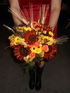 Fall wedding bouquet with sunflowers and cowgirl boots