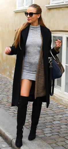 Sandra Willer wears a tight grey bodycon dress with patent black over the knee boots. Outfit: Nelly.