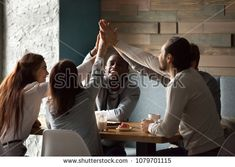 Various excited best friends raising hands giving high five together at meeting in cafe, happy multiracial students group promising unity support in good friendly relationships hanging in coffee house High Five, Unity, Raising, Relationships, Best Friends, Students, Hands, Group, Coffee