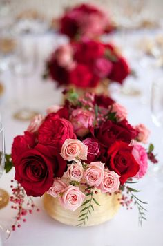 A mix of lush red roses and pink tea roses make the perfect centerpiece for a garden party.