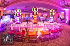 Custom LED lit centerpieces with pop art style lamp shade, very cool Andy Warhol bat mitzvah theme. Hot pink, purple, bright blue, orange colors. Love the alternative chair pads.  Bella's Bat Mitzvah Decor, Photography, and Entertainment by 84 West Events, www.SouthFloridaMitzvahs.com (954)236-9000
