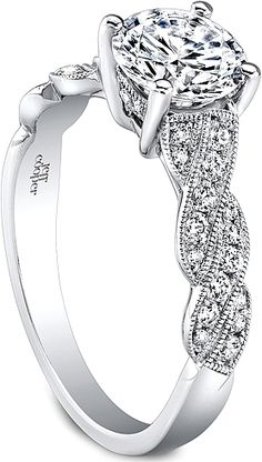 Jeff Cooper Braided Diamond Engagement Ring  : This diamond engagement ring setting by Jeff Cooper features round brilliant cut diamond pave set along a braided shank with a milgrain design that beautifully compliments the center stone of your choice.