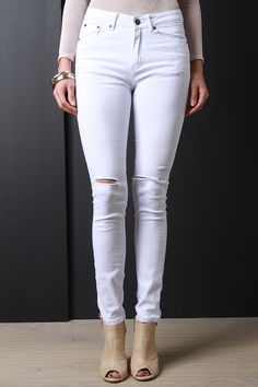 8538191e0e5 Shop Ripped Knee Skinny Jeans featuring ripped knees