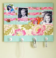 I forgot about this little project using a canvas, fabric, buttons and hooks. Adorable little organizer.
