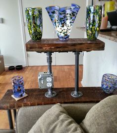 wood and black pipe table with wiring
