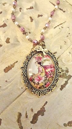 Pink Fairy Necklace, From Bertha Louise Designs, Hand made rosary chain, little cream bow, lovely Cicely Barker Fairy $25.00 including gift boxing and shipping.... Just message me here or facebook and mention Pink Fairy!!!!