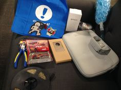May 2017 Woot BOC: blue shirt bag, bug repeller, set of 40 pins, blue bath brush, padded device carrier, iPhone 6 case, Lightning McQueen car, pliers, a 5 meter roll of LED strips, Woot F5 magnet, and zombie with boombox sticker.