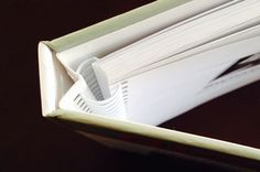A concealed Wire-O binding can used for either hardcover, hard case books, or soft cover books. The wire is concealed so it is not seen on the spine.