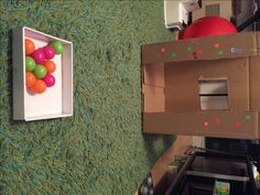 Throw balls in a box, 20 activities for 12-18 months old, 20 play ideas for toddlers, activities for one year old, montessori activities for a toddler, development promoting activities for toddlers, activities for 13 month old, activities for 14 month old, activities for 15 month old, activities for 16 month old, activities for 17 month old, activities for 18 month old, activities for a toddler, activities for one year olds, activities for two year olds