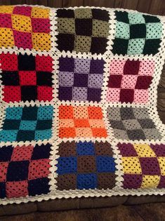 Checker Granny Square Blanket Throw afghan. It measures 48 X 60. It is made in granny square checkers. Different colors with a white trimming. I can change any color you want. Just tell me what you want made & I will be happy to make it for you. If you want it smaller are larger, just