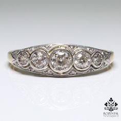 Period: Art deco (1920-1935) Composition: 18K gold and platinum. Stones: - 1 Old mine cut diamond of H-VS2 quality that weighs 0.20ctw. - 4 Old mine cut diamonds of H-VS2 quality that weigh 0.30ctw. R