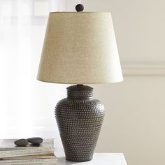 Somewhat masculine and definitely handsome, this bronze hammered lamp warms up living rooms, offices and dens equally well, thanks to its accommodating 3-way adjustable switch. So, how bright do you want your handsome to be?