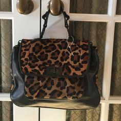 "REBECCA MINKOFF LEATHER AND PONY HAIR LEOPARD BAG ADORABLE REBECCA MINKOFF LEOPARD AND PONY HAIR HANDBAG shows wear including pony hair see above turn lock pic, does not have shoulder strap but one can easily be attached to loops.  MEASURES 13"" by 8"" by 3.5"" Rebecca Minkoff Bags"