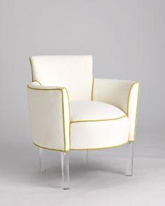 Chair with acrylic legs.