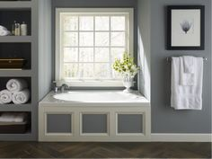 Built in shelves and a Jacuzzi Whirlpool tub add a modern feel to this bathroom.