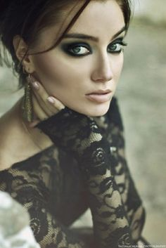 Her pale complexion, with brunette hair, smokey eyes, nude lips, and black lace garment are exquisite! (thinking this look for wedding makeup)