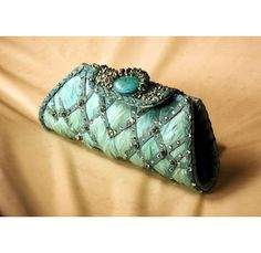 Aqua leather clutch, with feathers, swarovski and turquoise detail, $250