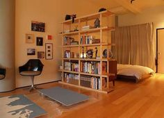 Open bookshelf room divider- something we are thinking about for our small bedroom/office loft space.