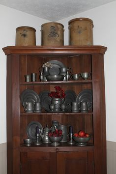 FARMHOUSE – INTERIOR – early american decor inside this vintage farmhouse seems perfect with a corner cabinet filled with a pewter collection.