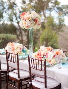 the tall arrangements should always go between table settings. Great example of this