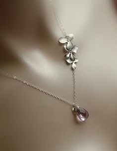 Light amethyst necklace with tiny initial charm and orchids. $43