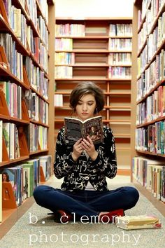 My daughters senior pics...she loves to read. That's her tattered Bible at her feet!
