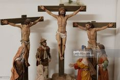 An scene of Jesus Christ crucified clay figurines stands on a shelf at Jose Luis Mayo's workshop on December 16, 2014 in Madrid, Spain. Jose Luis Mayo is a recognized artisan and the only in Madrid that produces hand made original clay figurines for Christmas Nativity Scenes. Jose Luis learned to work with clay on his own and keeps studying the culture and society of that epoch. At his workshop he has a team that reproduces handmade copies of his works on clay or ceramic.