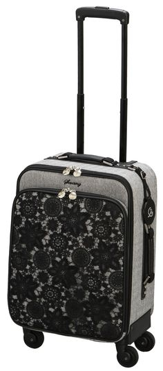 SWANY Grey Luggage with black lace ($699.00) Sold at Metro Paragon. Visit www.metro.com.sg for more information or LIKE our Facebook page at www.facebook.com/MetroSingapore