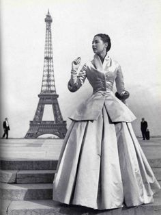 Dior's New Look photographed at the Eiffel Tower, 1947 vintage fashion designer couture evening gown long dress jacket skirt satin formal wear dress late 40s