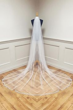 Stunning collection of Bridal Veils made in Ireland, different lengths and trims available.High quality Veiling and finish. Online Sales see website. Cater for different lengths and requirements. All designed and made in Dublin . This one is Satin edge veil, angel crystals can be added. Wedding Veils