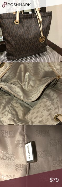 Michael Kors Jet Set Tote AUTHENTIC Michael Kors large Jet Set leather monogram tote. Very clean nice and roomy to hold all of your things. Purchased from Michael Kors store SMOKE FREE. Michael Kors Bags Totes