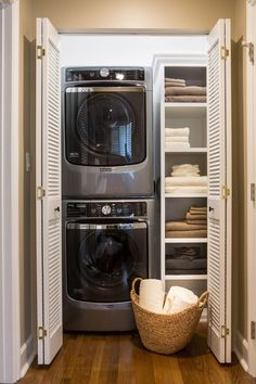 Within the master bedroom was a small entry hallway and extra closet, creating a perfect spot to carve out a small laundry room. Full-sized stacked washer and dryer sit next to adjustable shelves for holding supplies. New louvered doors offer ventilation and flow with the home's plantation shutters throughout.