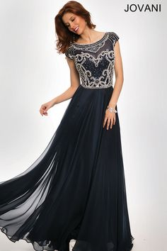 Gorgeous cap sleeve chiffon dress features a deep v back and crystal embellished bodice