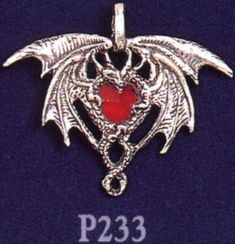 I had this but I think it was stolen. :(  Crystal Dragon Heart Pewter Pendant