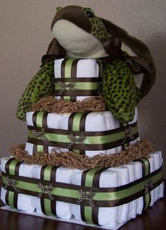 This Sea Turtle Square Diaper Cake is a custom order I just finished for a woman who really liked my Beary Special Delivery Square Diaper Cake but her sister in law was going with a turtle theme so I found this adorable sea turtle (the picture doesn't do this little guy justice) and created this fun diaper cake!   Blogged: www.LaDolceBoutique.blogspot.com