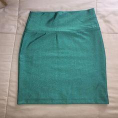Forever 21 Skirts - Forever 21 Turquoise Shine Mini Skirt