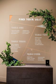 Modern Acrylic Seating Chart | Add simplicity to your modern wedding reception by creating your wedding seating chart out of clear acrylic plastic! A free standing sign is sure to impress your wedding guests as they stroll into the reception party. This particular sign has multiple geometric shapes created by diagonal copper foil lines