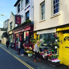 Cloudy in Brighton today, so here's a pic of colourful Kemptown village. Florists, Bookshop and a pub. The Barley Mow has recently been redec'd and has been rocking my world with pics of their  pies on their insta feed (not tried yet) #picoftheday #daysout #seaside #summer #instadaily #modernbricabrac #architecture #pies #Brighton #Hove #Sussex