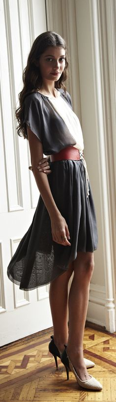 Feminine, but not overly girly. Soooo pretty, love the fabric, contrasting colours, and the belt.