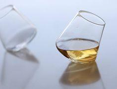 As you set the Cupa Glass down, it self-balances on its symmetrical base.