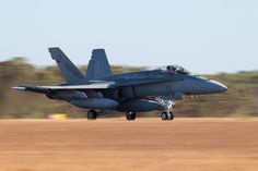 A RAAF F/A-18A Hornet takes off from RAAF Base Darwin during Exercise Pitch Black 14. #ExPB14